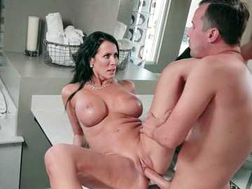 Middle-aged brunette Reagan Foxx gets her clam plowed by young gentleman